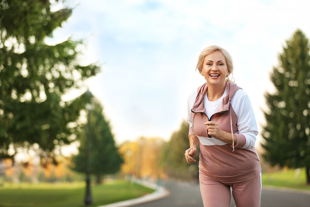 detoxing from alcohol, woman running with a smile on her face