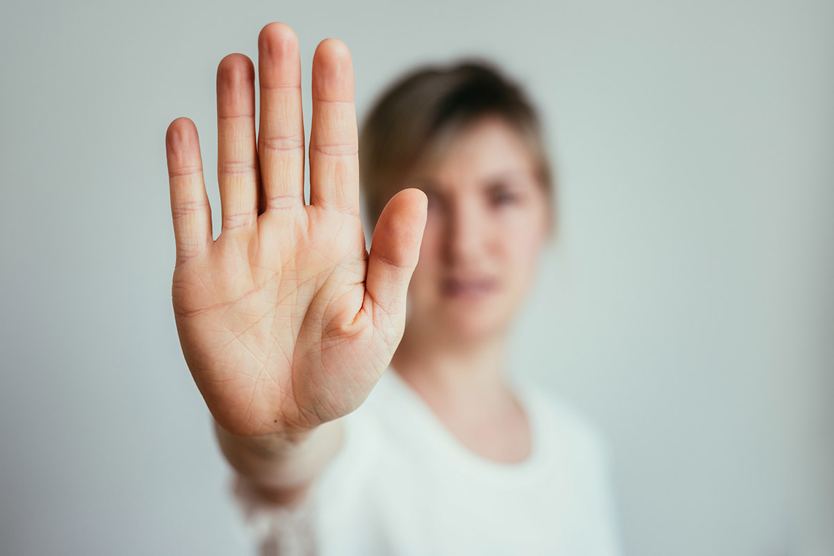 woman putting a hand up to stop the idea can i quit heroin cold turkey