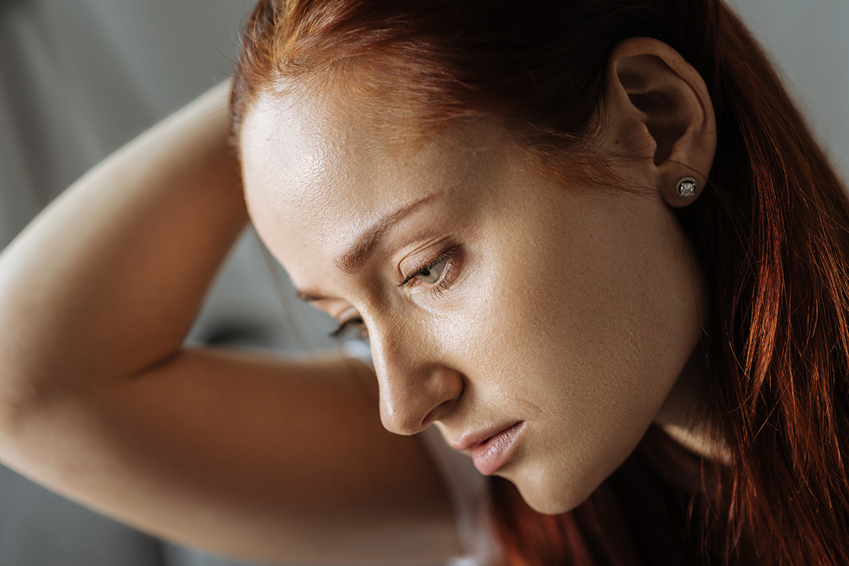 woman looking down worried about the Myths About Cocaine Addiction